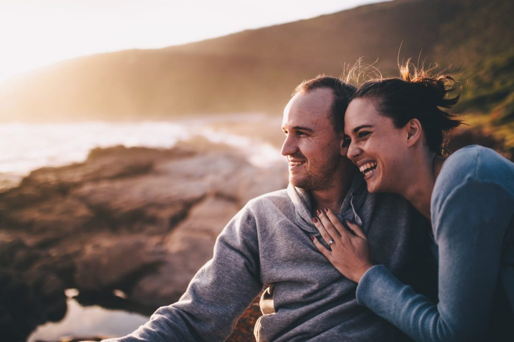 well-man-well-woman-sunset-couple-on-vacation-smiling-together-happy-relationship_t20_3Jrjp9